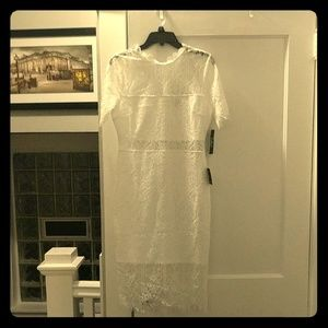 White medium lace dress...never worn